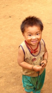 Dirty (and happy) little boy from the first village